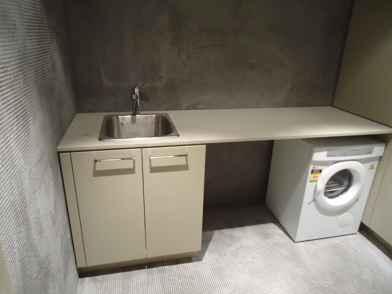 laundry machine cabinets